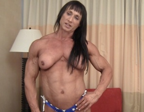 Female bodybuilder Tazzie Colomb poses topless for you in her bedroom the day after the Arnolds, looking vascular and ripped in tiny patriotic panties. Those muscular pecs, legs, biceps and abs look awesome, don't they?