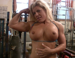 Bodybuilder Wende's playing with her pecs in the gym, masturbating her big wet clit in close-up, flexing her big  biceps and bending over so you can look at her gorgeous legs, glutes and ass. And she does it all standing up. Her panting and moaning will make you stand up too.