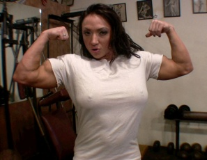 Bodybuilder BrandiMae's doing dumbbell curls in a skin-tight white t-shirt, but it's restraining her bulging biceps and pec muscles when she poses, so she rips it off, then pulls off her bikini bottom so she's naked in the gym. That's when she turns around to give you a good look at her sexy glutes and legs.