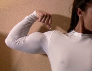 Bodybuilder Jenna really likes her new skin-tight top. Her back, biceps and abs look so good as she poses in it in the bedroom – you can even see how vascular she is in this video. She's nude below the waist, though, so she asks if you'd like to see the top come off. It's worth the wait.