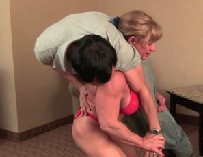 "Two movers show up at Wild Kat's place, but they don't realize she called them because she needed to move her body through a workout. First she subjects them to some verbal humiliation, smothering with her powerful pecs, and lift and carry with her strong legs and abs, as well as cock-and-ball torture. Then they worship her big biceps. She gives them both a hand job at the same time, along with some oral  to prepare them for muscle fucking and a hot bicep job (see it in close-up) so she can train evenly. What a workout – who needs a ""Shake Weight""?"