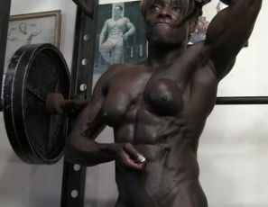 """Apparently domination is still the name of the game,"" female bodybuilder Roxanne Edwards says as she poses in the gym. She's nude. Her huge muscles are ebony, bulging and vascular, her abs are ultra-ripped, and her pecs,  legs, glutes, calves and biceps show she's right. Because she could definitely dominate you. Or just about anyone."