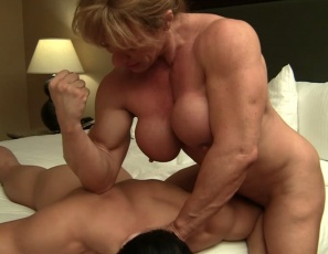 Wild Kat's client is expecting a gentle massage. Instead, she smothers him with her massive legs, then sits on his face and poses, flexing her pecs and big biceps. She masturbates and demands that he suck her big clit, then grinds it into his mouth until she cums. You get to see it all in extreme close-up. Then he gets some intense belly punching instead of the happy ending he was hoping for. Think he's happy?