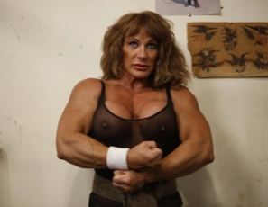 Bodybuilder Wild Kat is getting naked and wild in the gym, posing, flexing her big biceps, showing off her sexy pecs, legs and glutes, masturbating her big clit, close up, and indulging in some ass play. Are you ready to get wild?